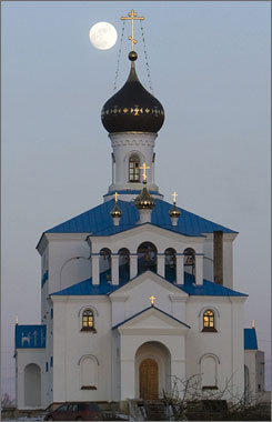 A full moon rises over an Orthodox church in the village of Miadel, north of Minsk. Easter is observed on the Sunday after the Paschal full moon, which occurs especially early this year.