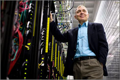 David Friend, CEO of Carbonite, an online backup company targeted at consumers, stands behind the stacks of servers at the data center in downtown Boston. About 3.2 million terabytes of data are backed up on multiple drives at the center.