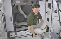International Space Station commander Peggy Whitson floats cross-legged in the Harmony module of the station during preparation for the opening of the hatches between ISS and the space shuttle Endeavour on March 13, 2008.