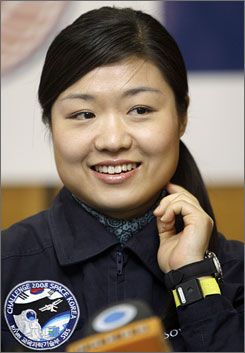 South Korea's first astronaut Yi So-yeon speaks at a news conference in Star City, Russia. She spent 10 days in space before a 3 1/2-hour, bone-jarring descent from the space station.