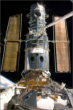 The Hubble Space Telescope resting in Discovery's cargo bay during the third repair mission in December 1999. The space shuttle's mission to repair the Hubble telescope, set for August 28, will be delayed four to five weeks.