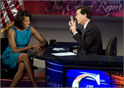 Stephen Colbert, host of Comedy Central's The Colbert Report, with Michelle Obama, wife of Democratic presidential hopeful Sen. Barack Obama, D-Ill., during a taping  of the show at the University of Pennsylvania in Philadelphia. Colbert won Webby Person of the Year.