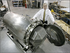 Brad Crain, president of BioSafe Engineering, stands by one of the company's steel cylinders in Brownsburg, Ind. Since they first walked the planet, humans have either buried or burned their dead. Now a new option using one of these cyclinders is generating interest:  dissolving bodies.