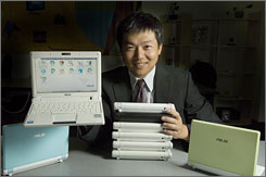 Asus North America President Jackie Hsu with Asus Eee PC Series computers at company offices in Fremont, Calif. The small laptops start at just $299.