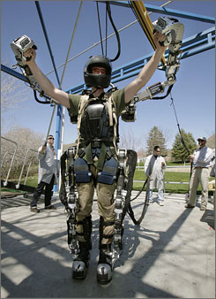 Software engineer Rex Jameson stretches in a robotic soldier suit being made for the U.S. Army by Raytheon in Salt Lake City. The suit can multiply its wearer's strength and endurance as many as 20 times, with relatively little loss of agility, by sensing and almost instantly amplifying every movement the wearer makes.