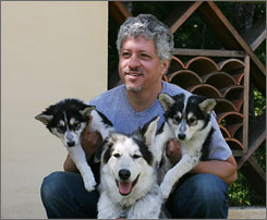 BioArts International chief executive Lou Hawthorne poses with dogs cloned from his family pet in Mill Valley, Calif. BioArts is offering to clone the dogs of the five highest bidders in an online auction next month.