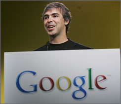 Google co-founder Larry Page smiles at news conference at Google headquarters in Mountain View, Calif., Tuesday, June 12, 2007.