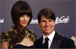Tom Cruise, right, and his wife Katie Holmes prior to the Bambi media award ceremony in Duesseldorf, Germany, in Nov. 2007. Cruise has launched a new website devoted to his career.