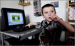 Six year old Zackary Villeneuve, who is autistic, uses the 'Zac browser' at his home in Saint Remi, Quebec. The Web browser was developed by his grandfather John LeSieur for use by autsitic children.