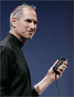 Apple CEO Steve Jobs demonstrates the first iPhone during his address at MacWorld Conference & Expo in San Francisco last year.