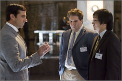 Steve Carell as Maxwell Smart, left, Nate Torrence as Lloyd, center, and Masi Oka as Bruce during a scene from the comedy Get Smart.     The movie riffs on tech gadgets that actually exist for the most part.