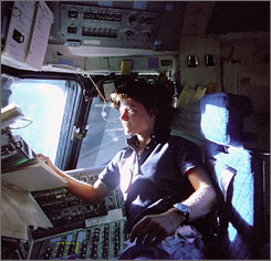 Astronaut Sally Ride, a specialist on shuttle mission STS-7, monitors control panels from the pilot's chair on the shuttle Columbia flight deck in this June 1983 photo. Ride became America's first woman in space 20 years ago when Columbia launched June 18, 1983