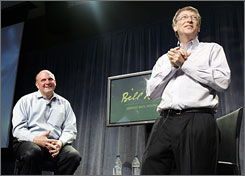Microsoft chairman Bill Gates, right, speaks to employees as CEO Steve Ballmer looks on, during a farewell event celebrating Gates years at Microsoft.