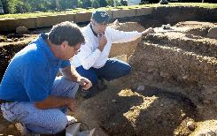 George Washington Foundation director of archaeology David Muraca, left, and research fellow Philip Levy examine evidence of a fire that damaged the Washington family home in 1740. Muraca and Levy led a team of dozens who identified and excavated the house at Ferry Farm in Stafford County, Va.