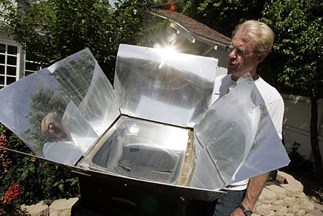 Actor Ed Begley Jr. displays a solar oven at his home in the Studio City district of Los Angeles.  Begley and his neighbor Bill Nye are locked in a friendly but serious eco-battle of keeping up with each other.