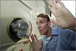Bill Nye watches his meter run backwards as his solar electric panels feed power back into the grid at his home in the Studio City district of Los Angeles.