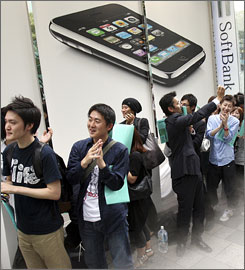 Customers waiting in line to buy the iPhone 3G celebrate as sales begin in Tokyo. Japan has a cloistered mobile system. That means many people, even iPhone fans, are likely to stick to their old-style phones lest they be left out of the familiar communication circles.