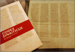 A leaflet on and original page of the Codex Sinaiticus at the university library in Leipzig, Germany. The Codex Sinaiticus will be available online by next July, digitally reconnecting parts in Britain, Russia, Germany and a monastery in Egypt's Sinai Desert.