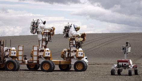 Two NASA astronauts drive their lunar truck in Moses Lake, Wash. NASA scientists and contractors spent two weeks at the remote location field testing some of the vehicles and robots they will use when humans return to the moon.