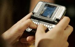 Morgan Pozgar of Claysburg, Pennsylvania, uses a phone to send a text message at the Roseland Ballroom in New York.