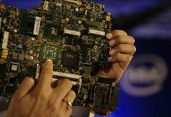 The newly launched Intel Centrino 2 processor technology in the motherboard of a laptop at a press conference in New Delhi, India.  Intel. is unveiling new technology that will let computers to wake up from their power-saving sleep state when they receive a phone call over the Internet.