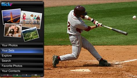 In this screen shot provided by the companies, a baseball game airs on the main part of the screen while various programs, like a personalized Flickr photo gallery seen here, run in a strip on the screen.
