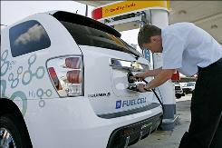 Thomas Albert, of Alexandria, Va., tries to fuel his Chevrolet Equinox Electric Fuel Cell Vehicle at a Shell Hydrogen Fueling station in Washington.