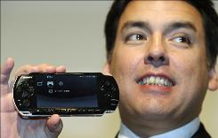 Sony Computer Entertainment Japan President Shawn Layden shows a PSP-3000, the revamped PlayStation Portable with an improved liquid crystal display and a built-in microphone, in Tokyo.