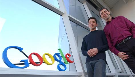 In this Jan. 15, 2004 file photo, Google co-founders Sergey Brin, left, and Larry Page pose at company headquarters in Mountain View, Calif. 