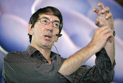 "Game designer Will Wright speaks about his latest game SPORE at a promotion event in Singapore August 13, 2008. Wright is the original designer of SimCity and ""The Sims"" computer games. SPORE will be released worldwide on September 7. REUTERS/Tim Chong (SINGAPORE) ORG XMIT: SGP103"