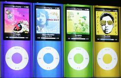 "A display of these redesigned iPod Nanos formed the backdrop for Apple's ""Let's Rock"" media event Tuesday in San Francisco featuring Steve Jobs."