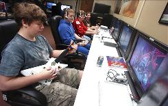 "Billy Nolte, foreground, plays ""Guitar Hero III"" during at Cyberdome in Easton, Pa. Cyberdome is a gaming center with 25 Xbox 360 consoles and two Nintendo Wiis connected to high-definition TVs that lets teens play video games in a social atmosphere."