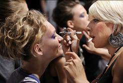 Makeup artist Danielle Fonseca applies high definition make-up backstage before the spring 2009 collection of Joanna Mastroianni is modeled during Fashion Week in New York. HD cosmetics, once used just for newscasters, models, and actors, are becoming more popular among women who want to appear like they would in HDTV: Lifelike, flawless and picture-perfect.