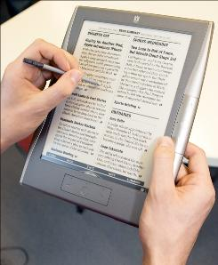 The iRex Digital Reader 1000S has a large, readable screen, but doesn't have an AC charger.