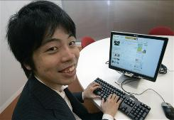 The founder and chief executive of mixi, Kenji Kasahara, smiles after logging into his company's social networking site in Tokyo. In Japan, the Internet is a realm where people stay safely within their circles of friends and few reveal themselves to strangers.