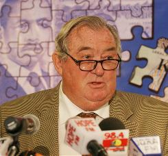 "Richard Leakey speaks in Nairobi, Kenya in 2007. Leakey warned that the worldwide credit crisis will be ""just devastating"" to scientific research in coming years, as endowment interest income drops and companies cut donations."
