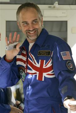 U.S. space tourist Richard Garriott, crewmember of the mission for the International Space Station waves at the Russian-leased Baikonur Cosmodrome in Kazakhstan.