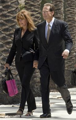 Broadcom Corp co-founder Henry Samueli and his wife Susan leave Federal Court after a sentencing hearing in Santa Ana, California September 8, 2008. Samueli pleaded guilty in June to a criminal charge of making a materially false statement to Securities and Exchange Commission investigators in a backdating case. Samueli, who served as Broadcom's chairman and chief technical officer, admitted to falsely telling U.S. Securities and Exchange Commission investigators in May 2007 he was not involved with options granting practices at the Irvine, California-based chipmaker, court documents showed.