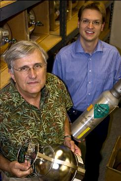Scripps geoscientists Ray Weiss, left, and Jens Muehle  in San Diego, Calif., stand amid collection cylinders used to collect air samples from a variety of locations around the world. Weiss and Muehle led a study that found that the greenhouse gas nitrogen trifluoride, used in the manufacture of flat-panel monitors, escapes to the atmosphere at levels much higher than previously assumed. Two major and potent greenhouse gases are building in the atmosphere, raising an unexpected new threat for accelerating global warming, new studies show. The gases are methane and nitrogen trifluoride, and their levels are building faster than expected.