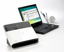The NeatDesk, left, here connected to a laptop, is a high-speed desktop scanner and digital filing system that scans receipts, business cards and documents.