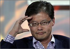 Yahoo CEO Jerry Yang listens to a question at the Web 2.0 Summit in San Francisco. Yang says the best move Microsoft can make is to buy Yahoo.