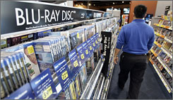 Blu-ray Discs are seen on display at Best Buy in Mountain View, Calif. Hollywood executives are hoping Blu-ray can help salvage their holiday.