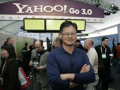 Yahoo CEO Jerry Yang poses for a photo in front of the Yahoo booth at the Consumer Electronics Show in Las Vegas in this Jan. 7 file photo.
