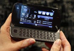 A model holds a Nokia cellphone.