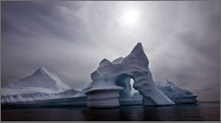 An iceberg melts off Ammassalik Island in Eastern Greenland in 2007. More than 2 trillion tons of land ice in Greenland, Antarctica and Alaska have melted since 2003, according to new NASA data.