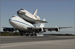 The space shuttle Endeavour returns atop a NASA 747 aircraft to the Kennedy Space Center in Cape Canaveral, Florida.