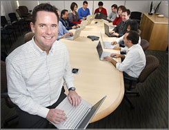 Todd Pierce, Genentech Inc.'s chief technology officer, poses for a photo with some of his employees in the company's headquarters in San Francisco.