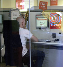 An unidentified man uses a computer at an Internet cafe in Sydney, Australia.