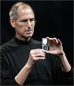 "Apple CEO Steve Jobs displays a redesigned iPod Nano at Apple's ""Let's Rock"" media event in San Francisco last September."