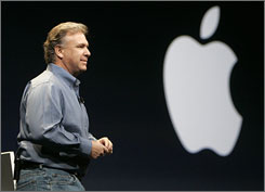 Apple's Phil Schiller talks about software enhancements during his address at the Macworld Conference and Expo on Tuesday in San Francisco. GarageBand '09 includes videotaped, interactive music lessons given by Norah Jones, shown on screen, and other musicians.